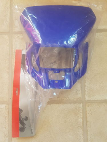 Headlight surround/mask - blue - genuine Yamaha part